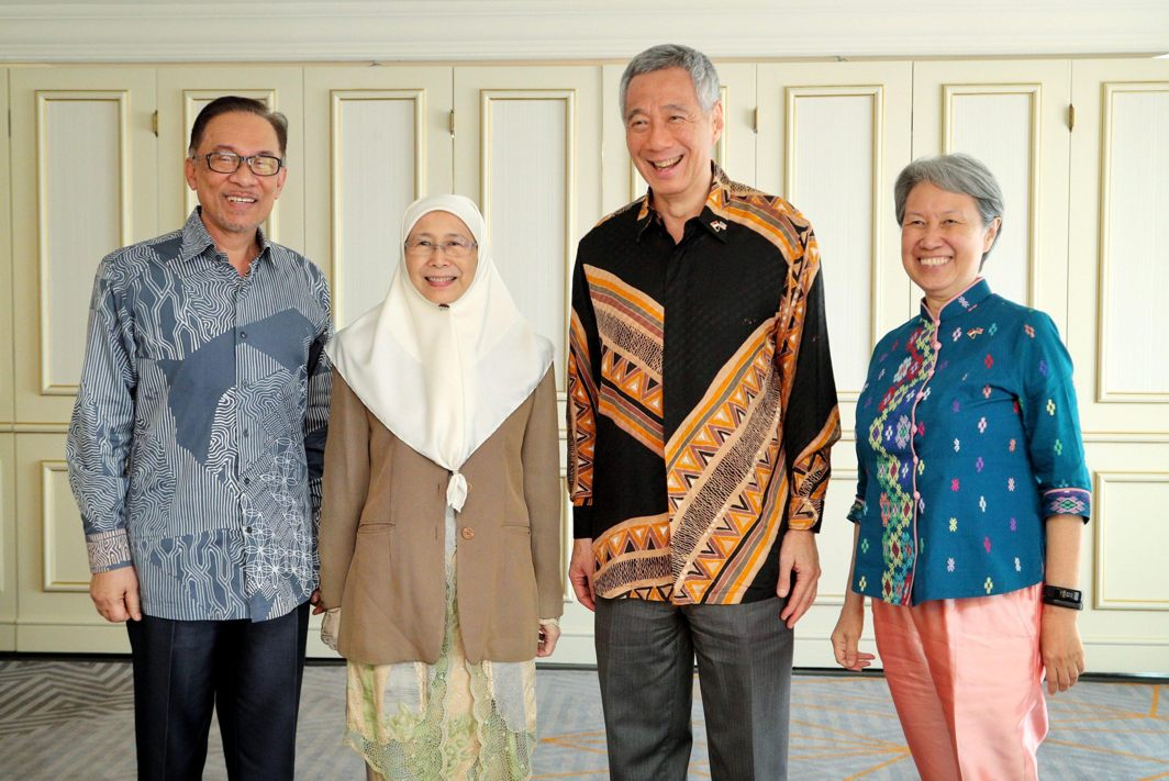 Singapore's Prime Minister Lee Hsien Loong and his wife Ho Ching pose for a photo with Malaysian politician Anwar Ibrahim and his wife Malaysia's Deputy Prime Minister Wan Azizah Wan Ismail, during a meeting in Kuala Lumpur, Singapore's Ministry of Communications and Information/Reuters/UNI