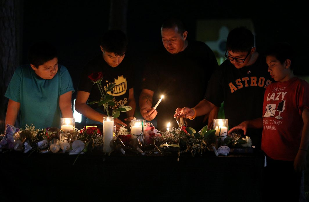The Cardenas family light a candle to pay their respects to the victims of a shooting at Santa Fe High School that left several dead and injured in Santa Fe, Texas, US, Reuters/UNI