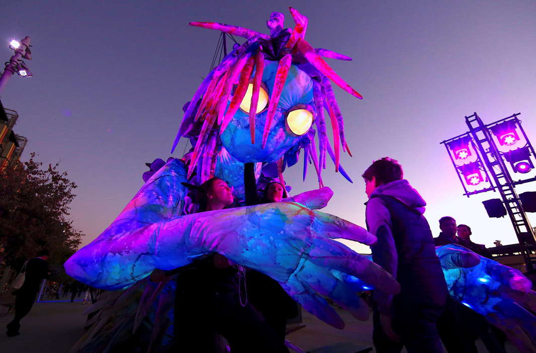 A boy looks at a six-metre tall luminescent puppet, operated by ten performers, during a preview of Vivid Sydney, promoted as the world's largest festival of light, music and ideas, in Sydney. The festival will run for 23 days, starting on May 25, Reuters/UNI