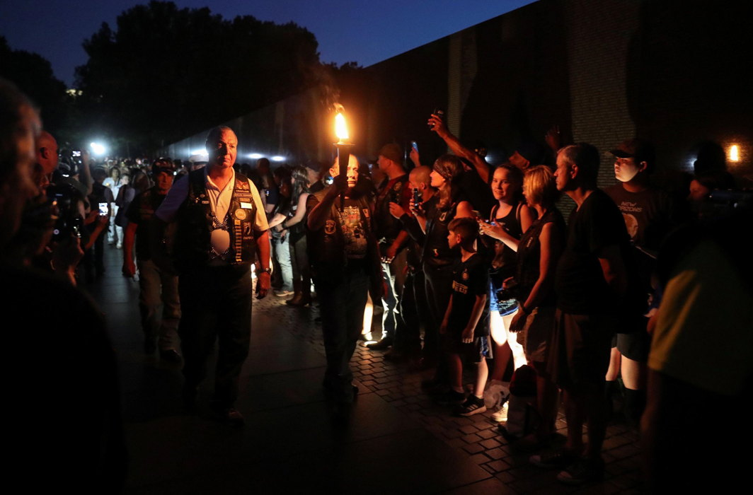 Rolling Thunder motorcyclists, who ride annually on Memorial Day in support of US military veterans, hold a torchlit vigil at the Vietnam Veterans Memorial on the National Mall in Washington, Reuters/UNI
