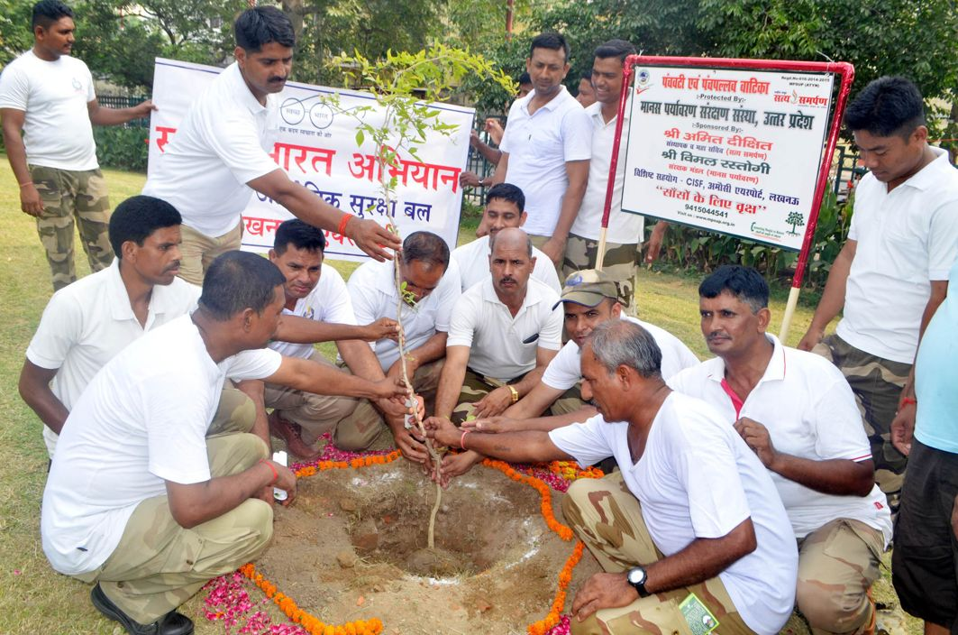 CISF personnel participate in a tree plantation drive on the eve of World Environment Day, at Amausi Airport, in Lucknow, UNI