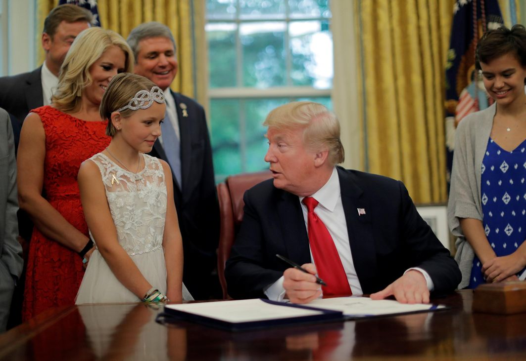 US President Donald Trump participates in the signing ceremony for S 292, The Childhood Cancer Survivorship, Treatment, Access, and Research Act of 2018, at the Oval Office of the White House in Washington, US, Reuters/UNI