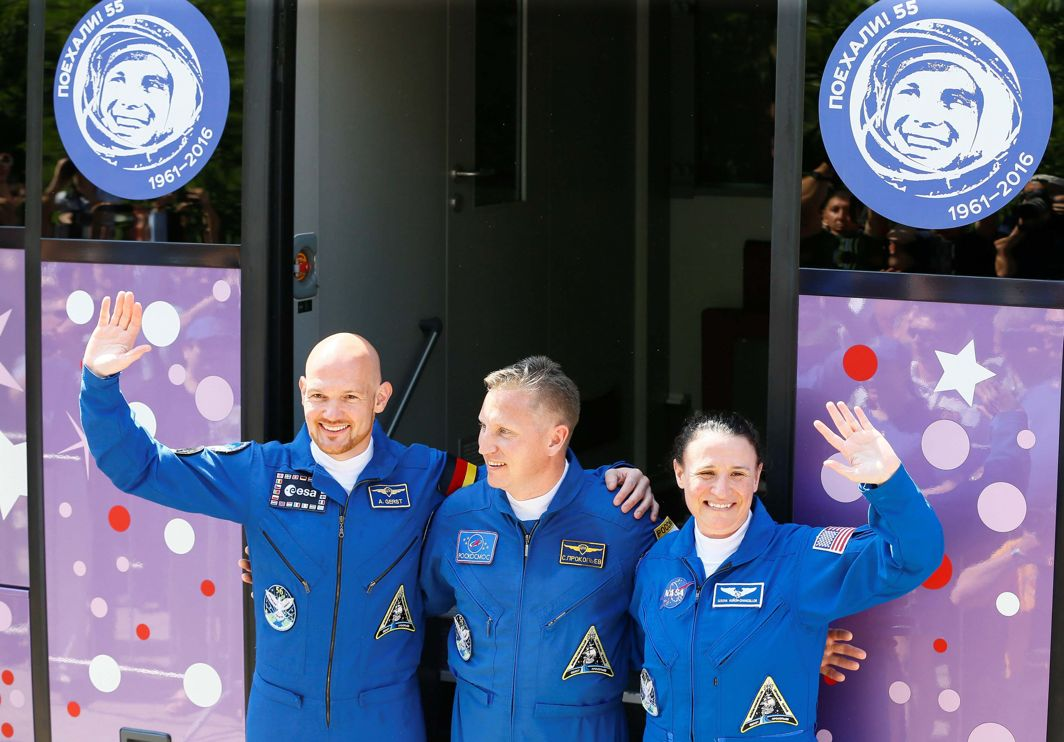 The International Space Station (ISS) crew members Serena Aunon-Chancellor of the US, Alexander Gerst of Germany and Sergey Prokopyev of Russia wave in front of a bus before leaving for a pre-launch preparation at the Baikonur Cosmodrome, Kazakhstan, Reuters/UNI