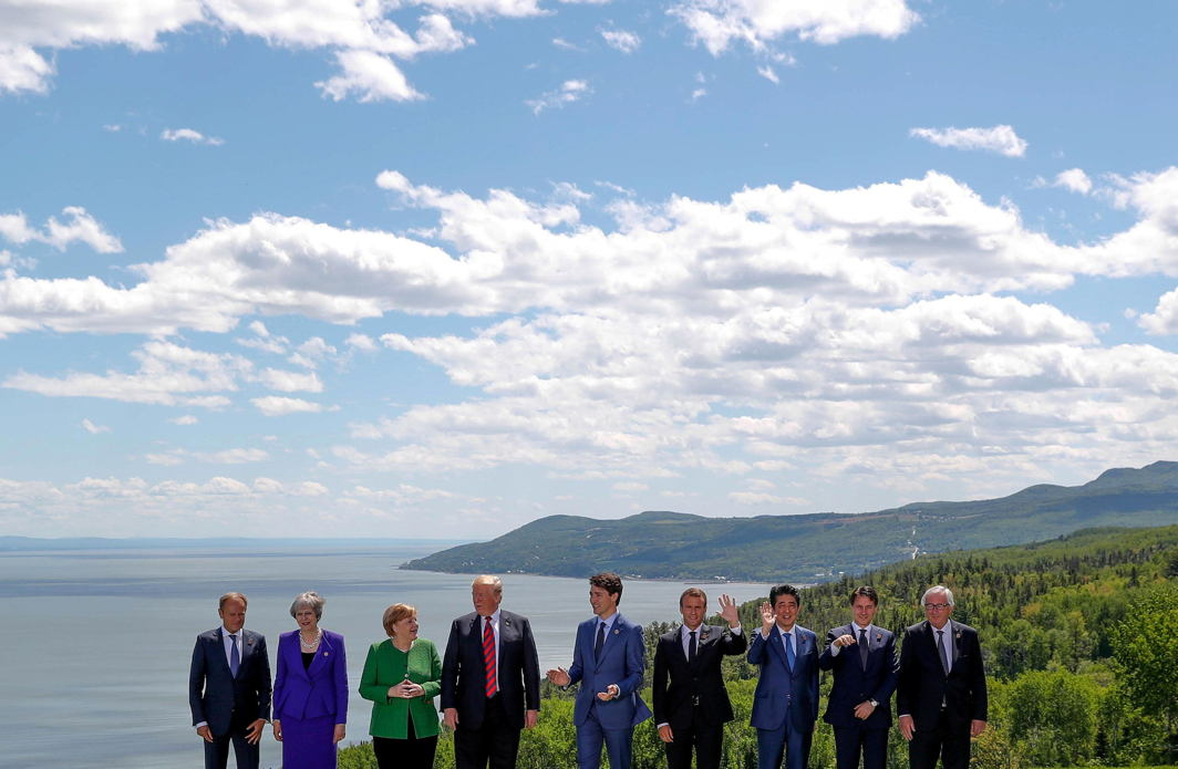 European Council President Donald Tusk, Britain's Prime Minister Theresa May, Germany's Chancellor Angela Merkel, U.S. President Donald Trump, Canada's Prime Minister Justin Trudeau, France's President Emmanuel Macron, Japan's Prime Minister Shinzo Abe, Italy's Prime Minister Giuseppe Conte and European Commission President Jean-Claude Juncker pose for a family photo at the G7 Summit in the Charlevoix city of La Malbaie, Quebec, Canada, Reuters/UNI
