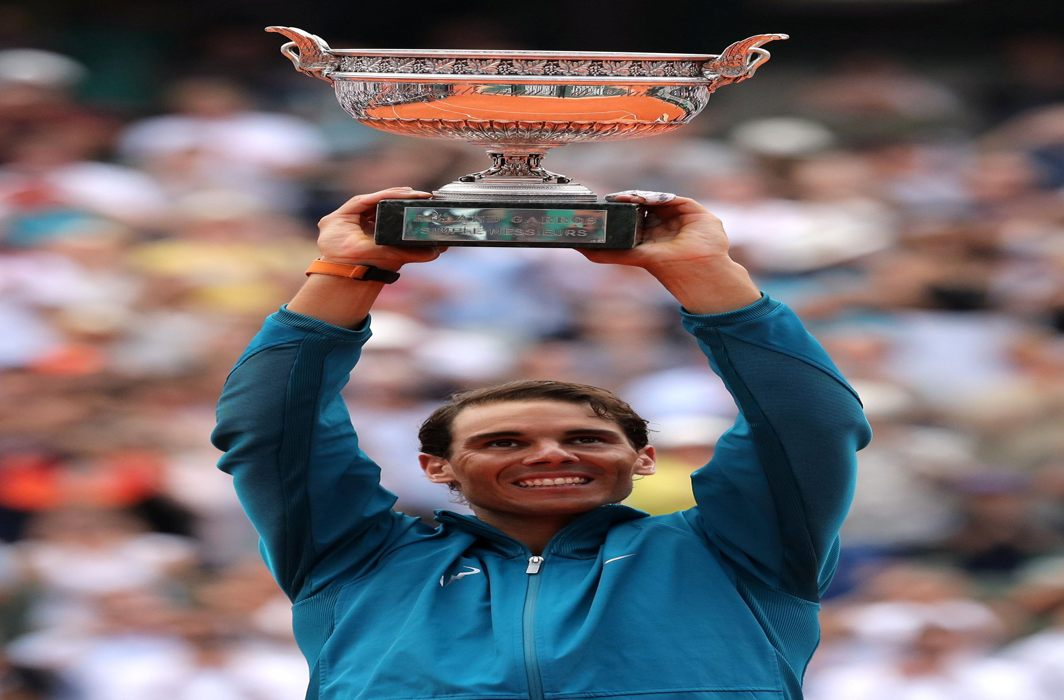 Spain's Rafael Nadal celebrates with the trophy after his emphatic win in the final against Austria's Dominic Thiem during the French Open Championship at Roland Garros, Paris, France, Reuters/UNI