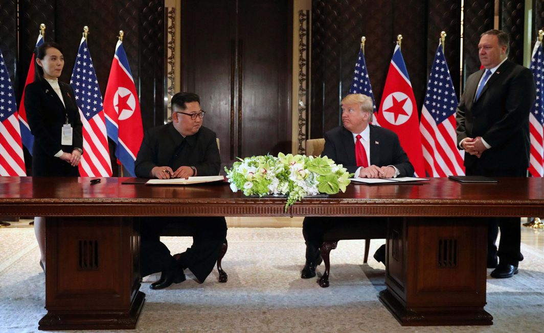 US President Donald Trump and North Korea's leader Kim Jong Un look at each other before signing documents that acknowledge the progress of the talks and pledge to keep momentum going, after their summit at the Capella Hotel on Sentosa island in Singapore. They are flanked by Kim Yo Jong, sister of North Korean leader Kim Jong Un, and US Secretary of State Mike Pompeo, Reuters/UNI