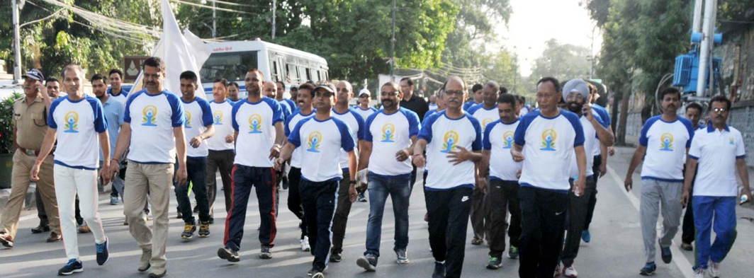 Uttarakhand Chief Secretary Utpal Kumar Singh participates in a Walk For Yoga, an Yoga awareness walk, ahead of International Day of Yoga, in Dehradun, UNI