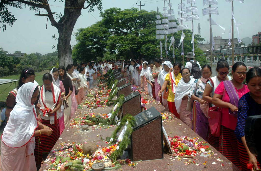 People pay homage to the 23 martyrs, on the 17th anniversary of the Great June Uprising Unity Day, at the memorial site in Kekrupat near Kangla Fort in Imphal, UNI