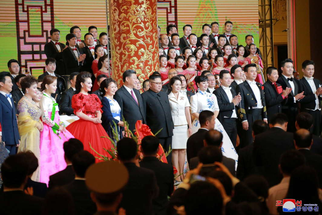 North Korean leader Kim Jong Un and his wife Ri Sol Ju stand beside Chinese President Xi Jinping and his wife Peng Liyuan in Beijing, China, KCNA/Reuters/UNI