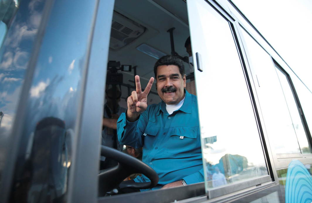 Venezuela's President Nicolas Maduro gestures as he drives a bus during the inauguration of a public transportation route in Caracas, Miraflores Palace/Reuters/UNI