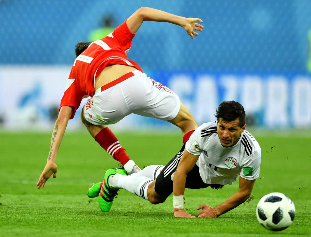 Egypt's Tarek Hamed in action with Russia's Aleksandr Golovin during their World Cup Group A match at Saint Petersburg Stadium, Saint Petersburg, Russia, Reuters/UNI