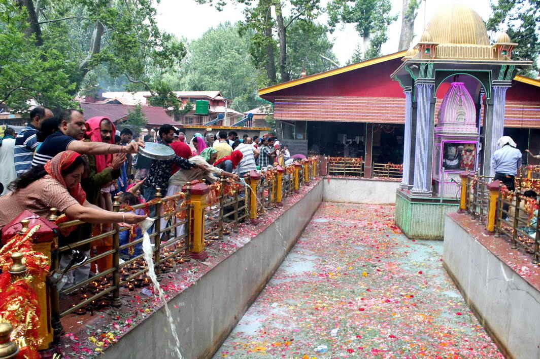 Devotees offer milk in the spring as a mark of 'puja' on the occasion of Mela Kheer Bhawani at Tulmula, in Ganderbal district in Central Kashmir, UNI