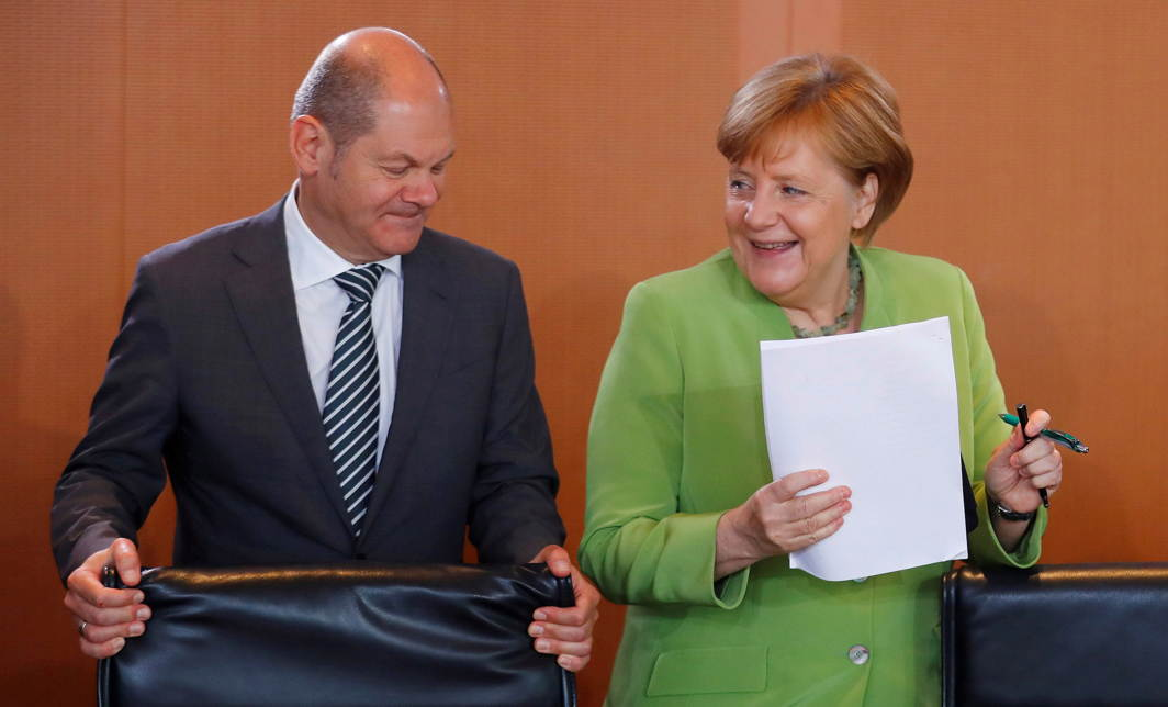 German Chancellor Angela Merkel and German Finance Minister Olaf Scholz arrive for the weekly cabinet meeting at the Chancellery in Berlin, Germany, Reuters/UNI