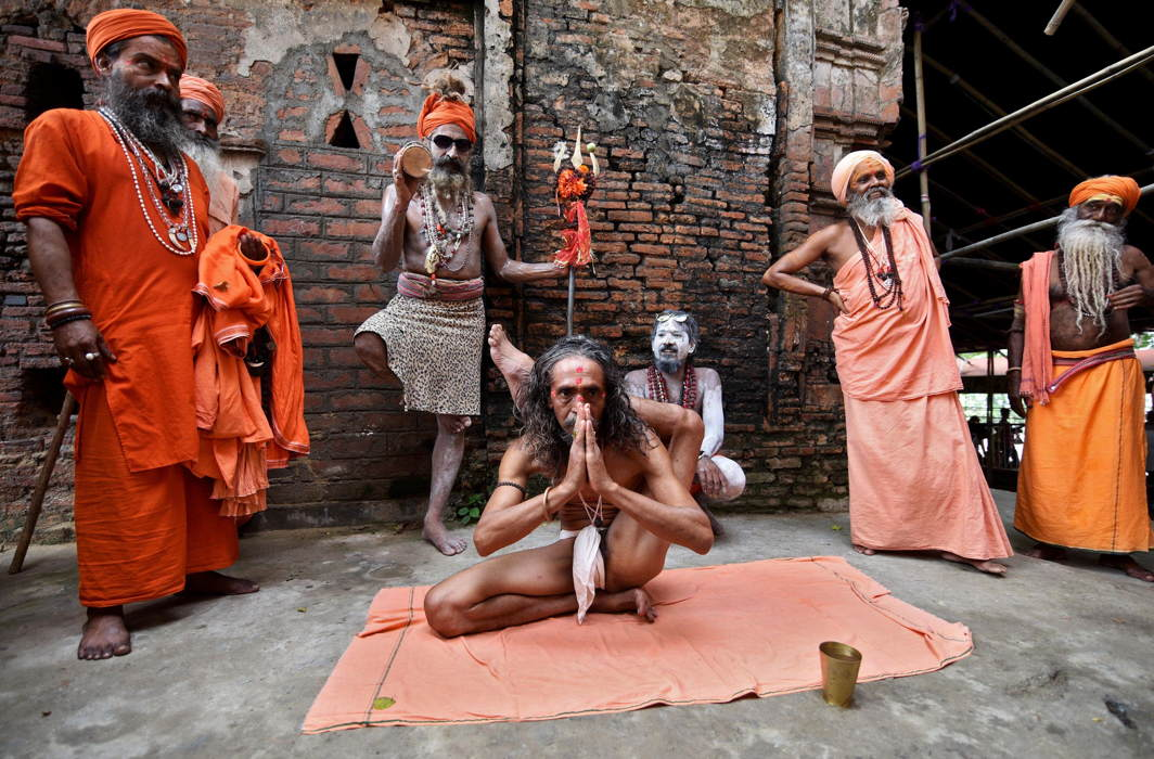 Sadhus perform yoga on International Yoga Day at the Kamakhya temple in Guwahati, Reuters/UNI