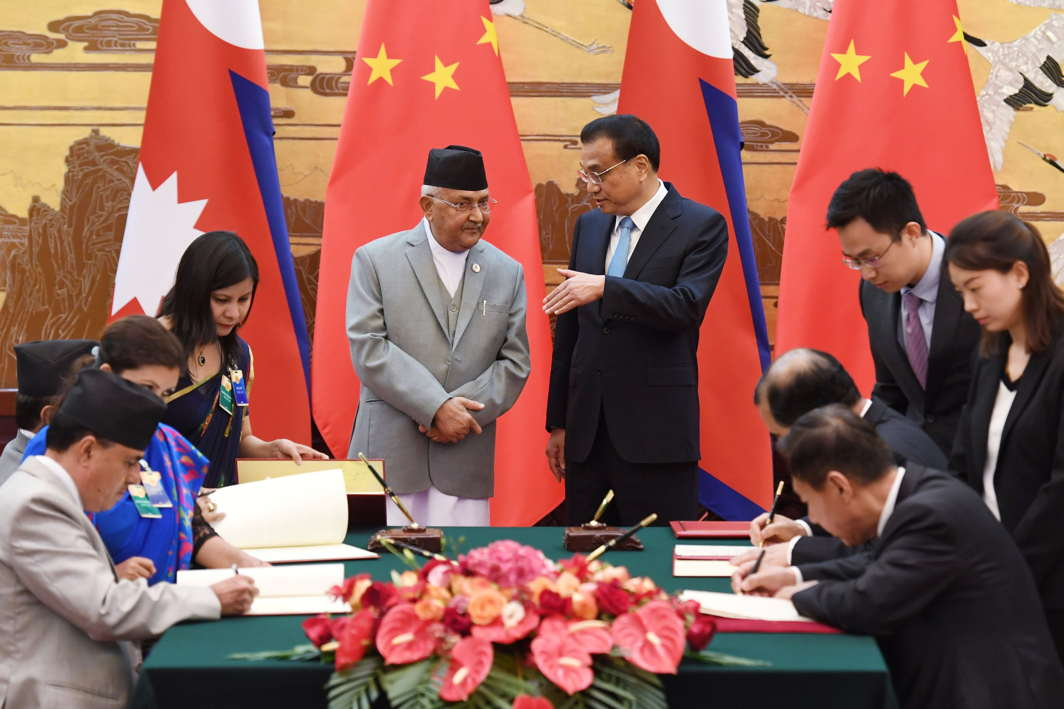 Nepal's Prime Minister KP Sharma Oli and Chinese Premier Li Keqiang speak during a signing ceremony at the Great Hall of the People in Beijing, Greg Baker/Pool/Reuters/UNI
