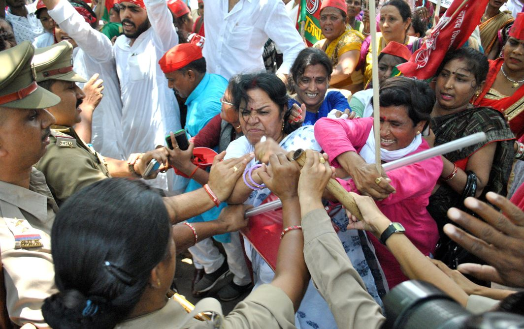 Activists of the Samajwadi Party women's wing scuffle with police during their protest against price hike of essential commodities in Lucknow, UNI