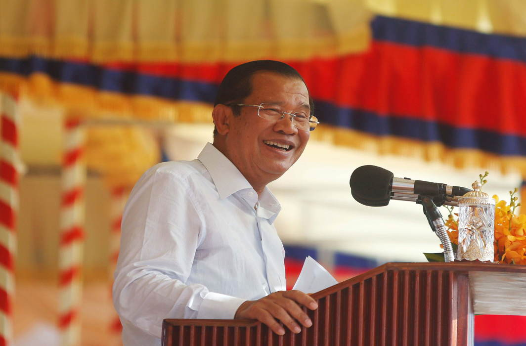 Cambodia's Prime Minister Hun Sen smiles during a rally with garment workers in Kandal province, Reuters/UNI
