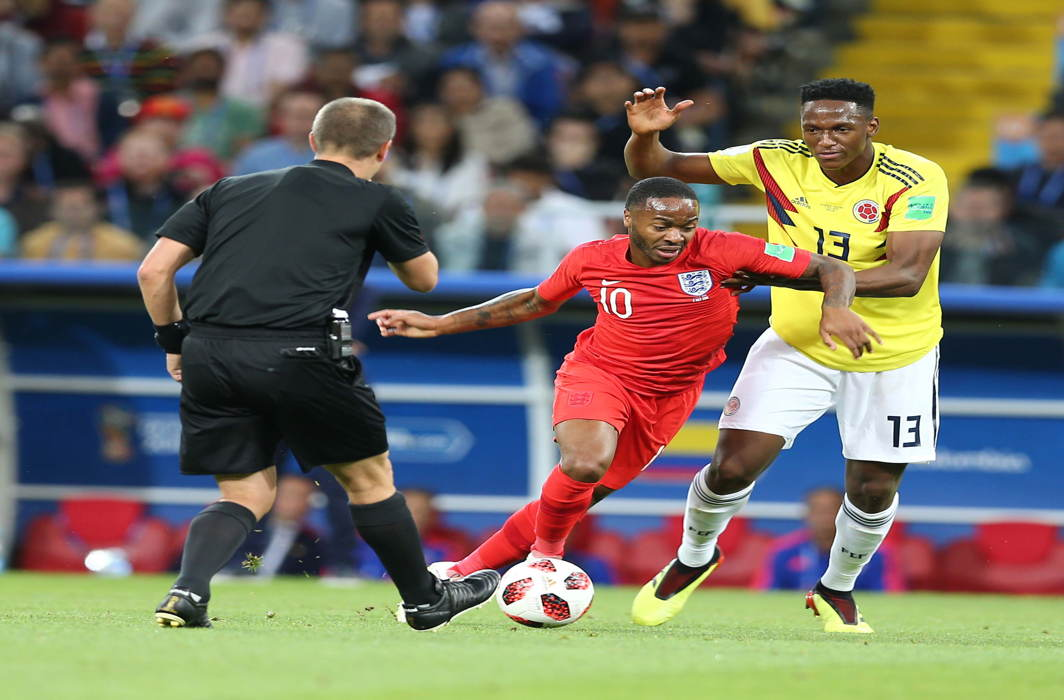 Colombian player Yerri Mina and England's Raheem Sterling in action at Spartek Stadium, in Moscow; England beat Colombia on penalties 4-3 to enter the last eight, UNI
