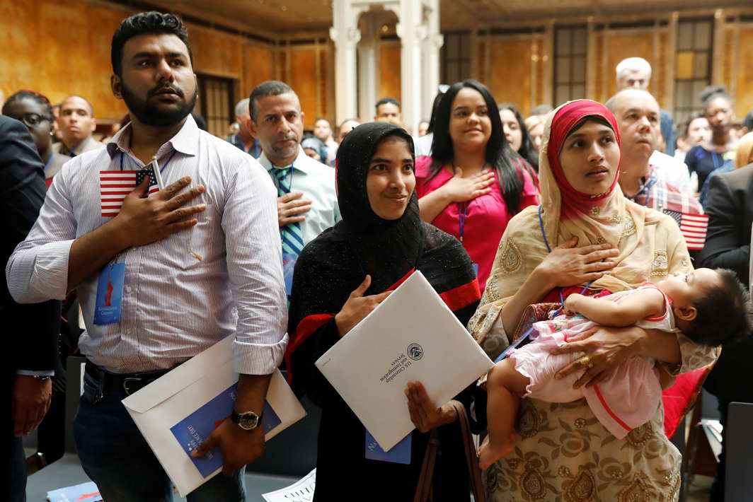 New citizens stand during the National Anthem at a US Citizenship and Immigration Services (USCIS) naturalisation ceremony at the New York Public Library in Manhattan, New York, Reuters/UNI