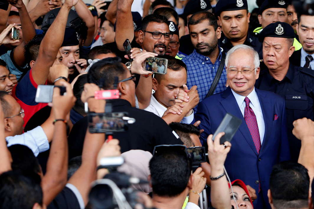 Malaysia's former Prime Minister Najib Razak greets his supporters as he leaves a court in Kuala Lumpur, Reuters/UNI