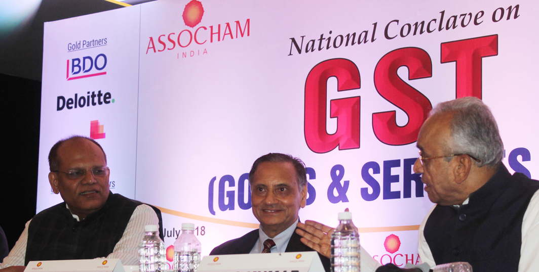 Telangana Principal Secretary, Commercial Taxes and Excise, Somesh Kumar with Gowra Srinivas, President, FTAPCCI, during a national conclave on GST in Hyderabad, UNI