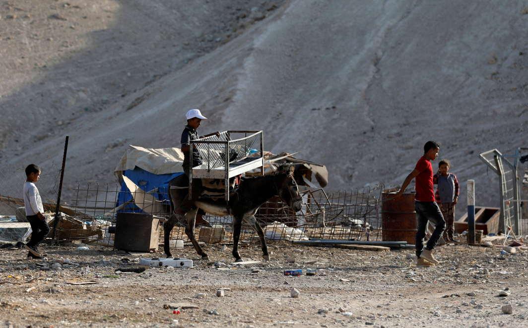 A Palestinian Bedouin boy rides a donkey in al-Khan al-Ahmar near Jericho in the occupied West Bank, Reuters/UNI