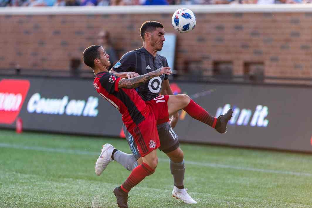 Minnesota United defender Michael Boxall (15) and Toronto FC forward Sebastian Giovinco (10) fight for the ball during the second half at TCF Bank Stadium, Minneapolis, USA; Harrison Barden/USA Today/Reuters/UNI