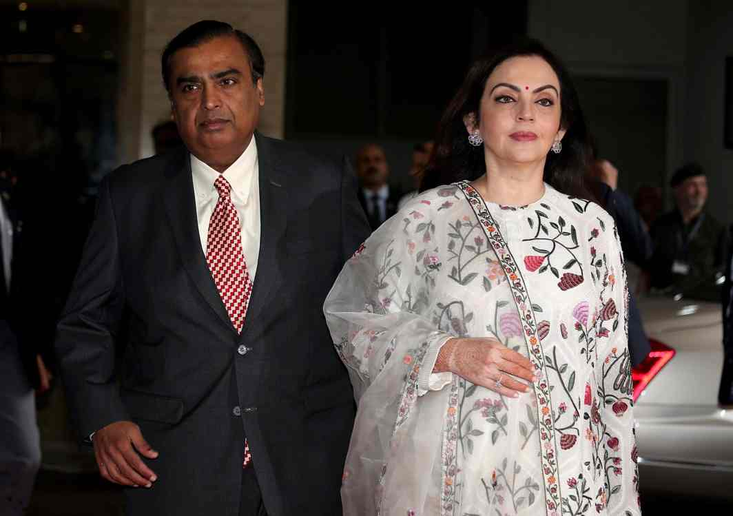Mukesh Ambani, Chairman and Managing Director of Reliance Industries, arrives with his wife Nita Ambani to address the company's annual general meeting in Mumbai, India, Reuters/UNI