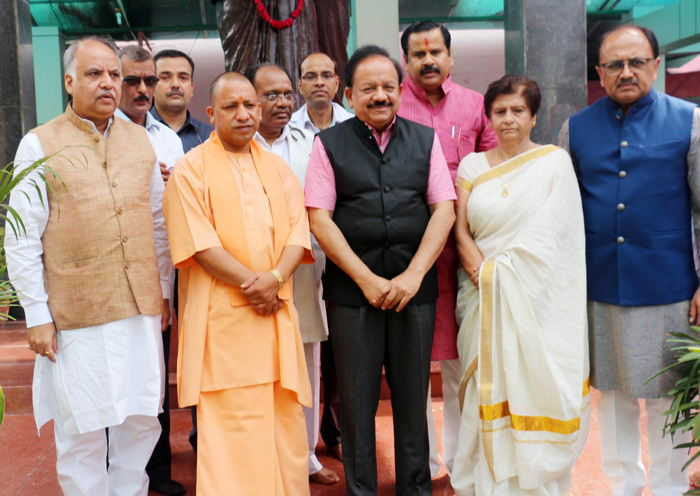 Uttar Pradesh Chief Minister Yogi Adityanath with Union Minister Harshwardhan and others after paying floral tributes to Dr Syama Prasad Mookerjee on his 118th birth anniversary in Lucknow, UNI