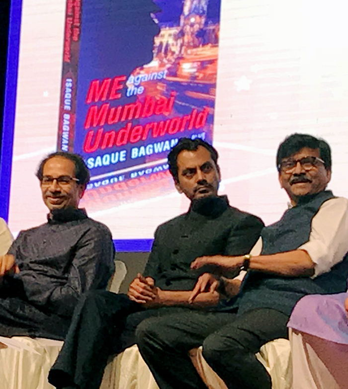 Shiv Sena chief Uddhav Thackeray with party leader Sanjay Raut and actor Nawazuddin Siddiqui at the book release of 'Me Against The Mumbai Underworld' authored by supercop Isaque Bagwan, in Mumbai, UNI