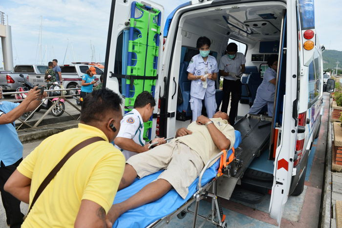 A rescued tourist is attended by medical personnel after a boat he was travelling in capsized off the tourist island of Phuket, Thailand, Reuters/UNI