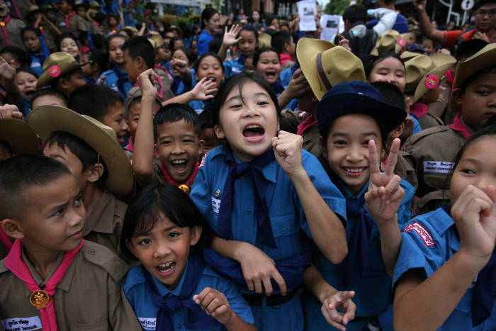 Students celebrate in front of Chiang Rai Prachanukroh Hospital, where the 12 soccer players and their coach rescued from the Tham Luang cave complex are being treated, in the northern province of Chiang Rai, Thailand, Reuters/UNI