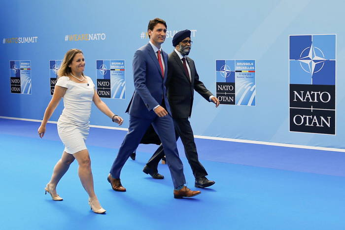 Canada's Prime Minister Justin Trudeau, Foreign Minister Chrystia Freeland and Defence Minister Harjit Sajjan arrive at the Alliance's headquarters ahead of the NATO summit in Brussels, Belgium, Reuters/UNI