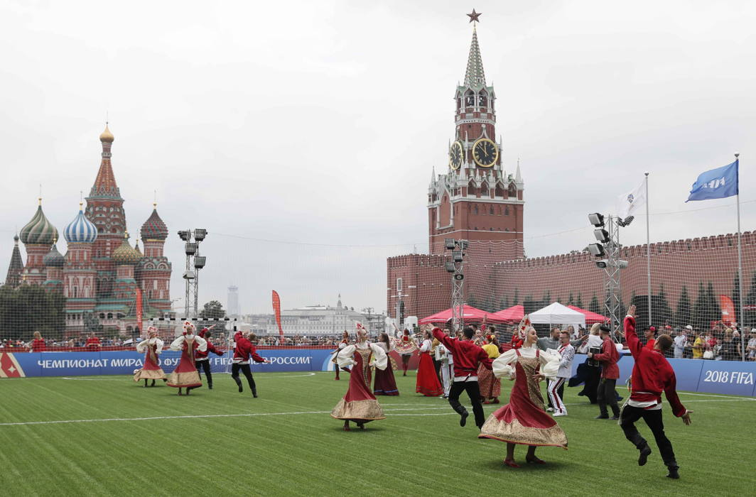 Performers in traditional costumes dance after an exhibition match between teams of footballing legends in the World Cup Football Park in Red Square in central Moscow, Russia, Reuters/UNI