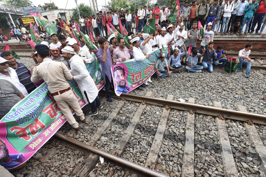 Jan Adhikar Party activists block railway tracks during their protest against the allocation of examination centres for the Railway Group C examinations in far off places, in Patna, UNI