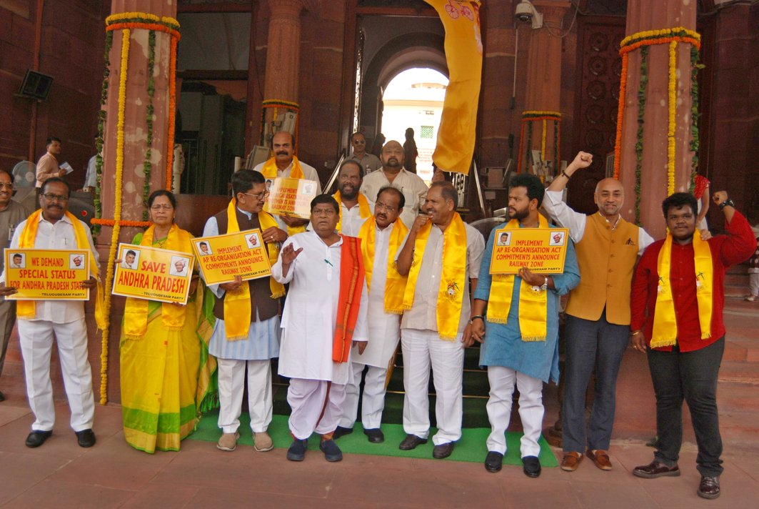TDP MPs hold a demonstration in support of their various demands, in Parliament House, New Delhi, UNI