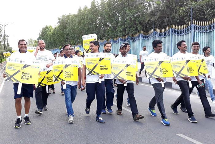 People participate in a Road Safety Awareness Walk 2018, on the eve of National Bone and Joint Day organised by KIMS Hospitals in association with TCOS (Twin-cities Orthopaedics society) and Indian Orthopaedic Association at Necklace Road in Hyderabad, UNI