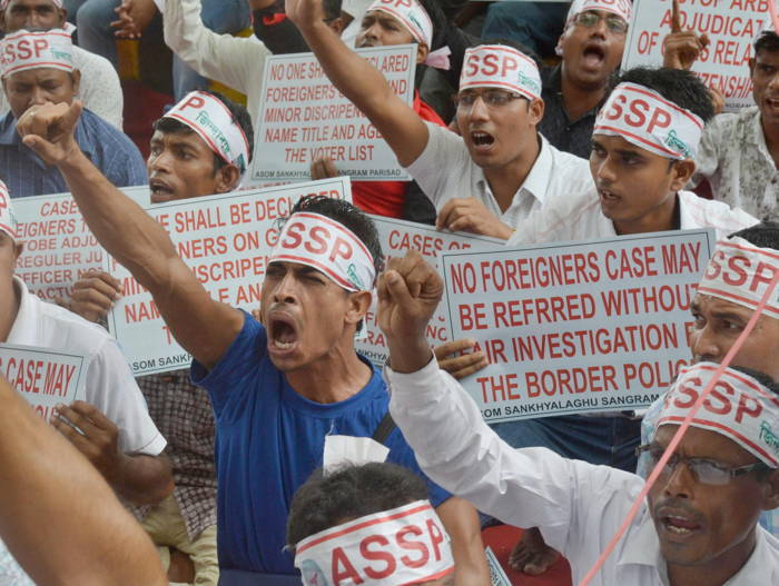 Members of Asom Sankhayalghu Sangram Parishad (ASSP) raise slogans during a demonstration in protest against arbitrary exclusion of Indian Citizens from NRC, at Parliament Street in New Delhi, UNI