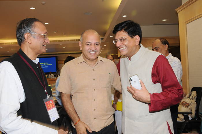 Union Finance Minister Piyush Goel meets West Bengal Finance Minister Amit Mitra and Delhi Deputy Chief Minister Manish Sisodia during the 29th meeting of GST Council at Vigyan Bhawan, in New Delhi, UNI
