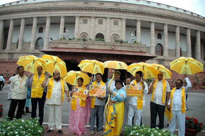 TDP MPs hold a demonstration at Parliament House demanding special status for Andhra Pradesh, in New Delhi, UNI
