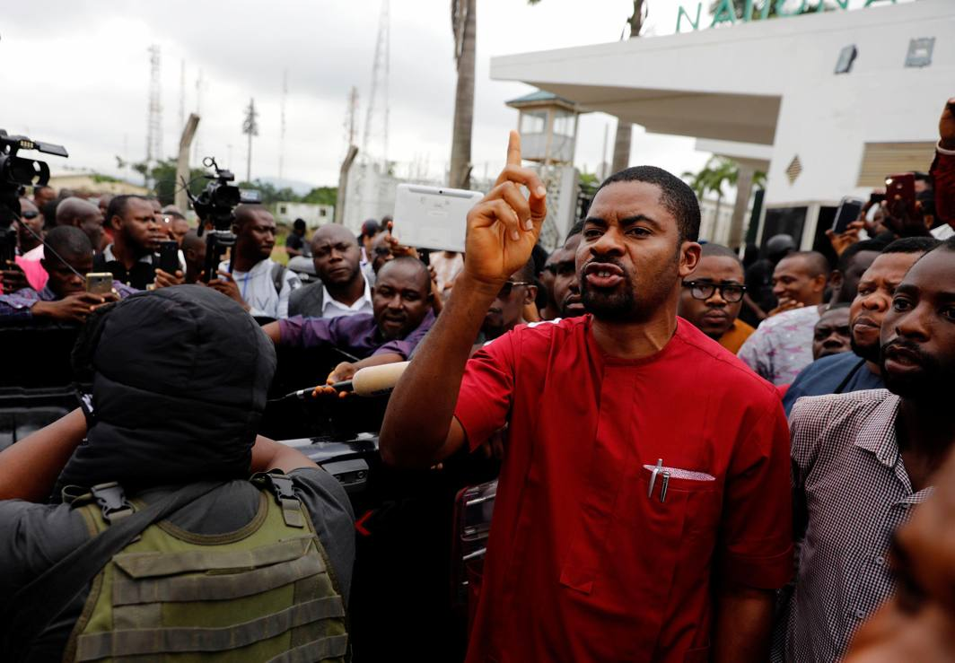 A man reacts at the entrance of the National Assembly in Abuja, Nigeria, Reuters/UNI