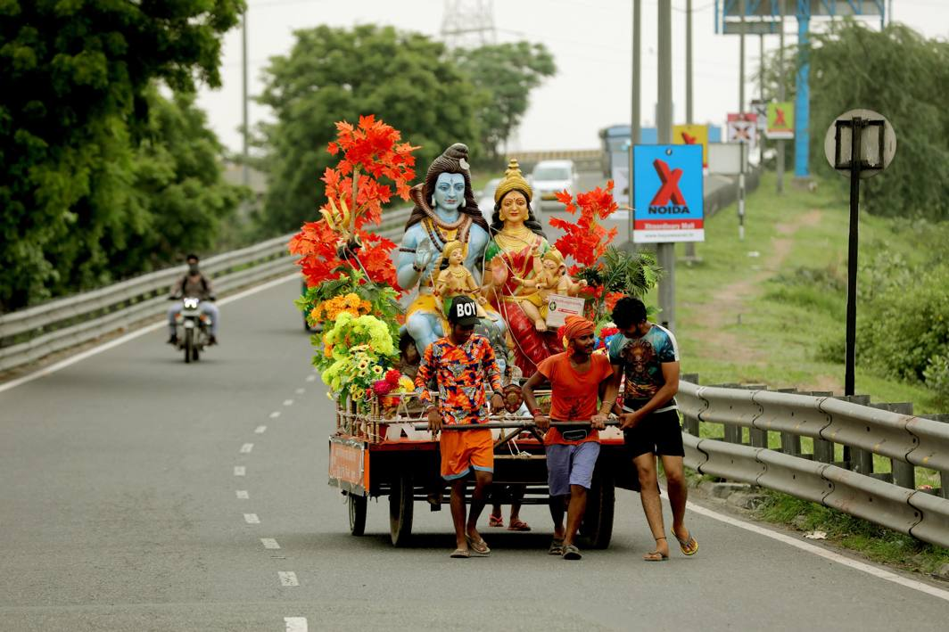 Kanwarias carry holy gangajal from Haridwar on way to their native places through a road in New Delhi, UNI