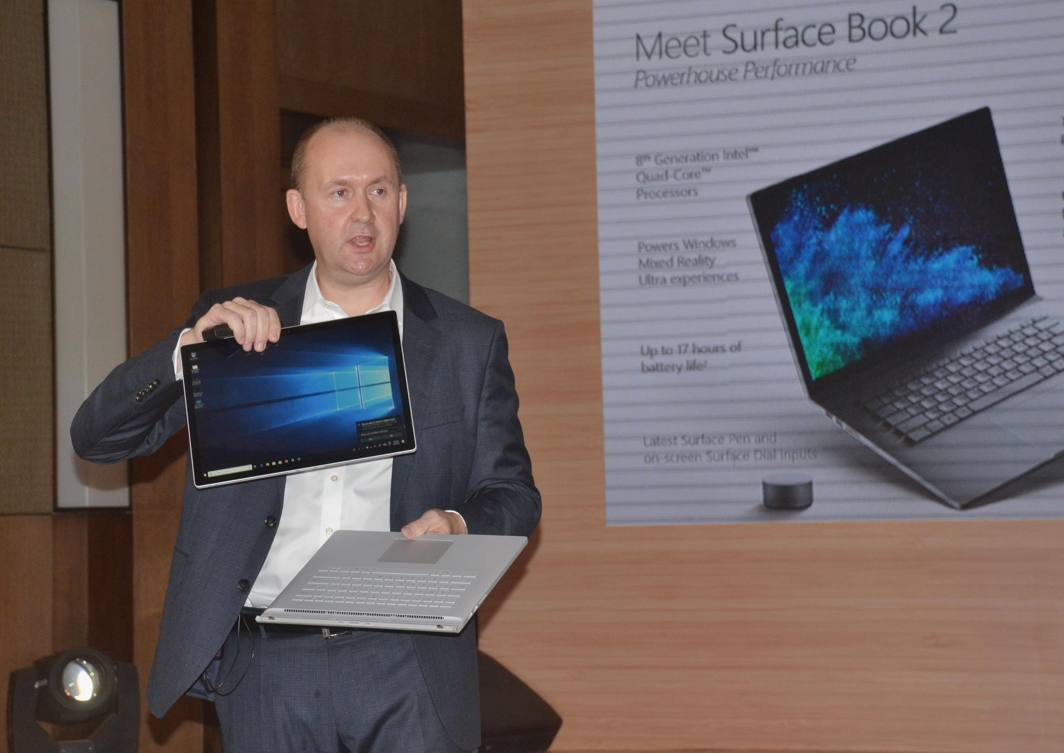 Jason Trump, Director, Surface Enterprise Sales (Asia), Microsoft Corporation, launches Microsoft Surface Book-2 and Surface Laptop at a press conference, in New Delhi, UNI