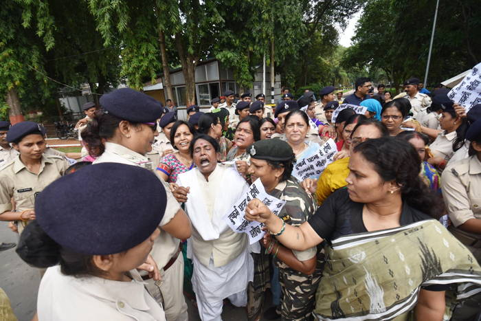 Rashtriya Janata Dal women block the main entrance of the Bihar Chief Minister's residence in protest against the Muzaffarpur shelter rape case, in Patna, UNI