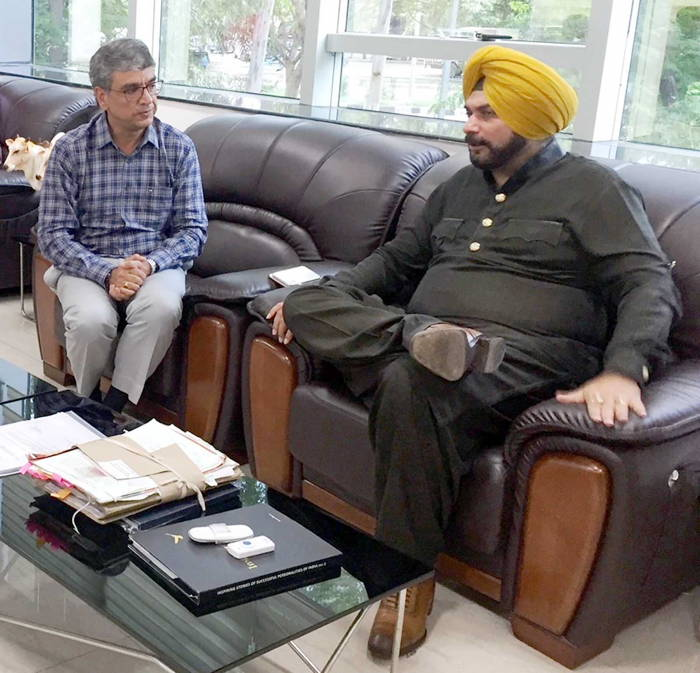 Punjab Tourism and Cultural Affairs Minister Navjot Singh Sidhu at a meeting with Himachal Pradesh Additional Chief Secretary, Culture and Tourism Ram Subhag Singh, before signing of MoU between both the states in Chandigarh, UNI