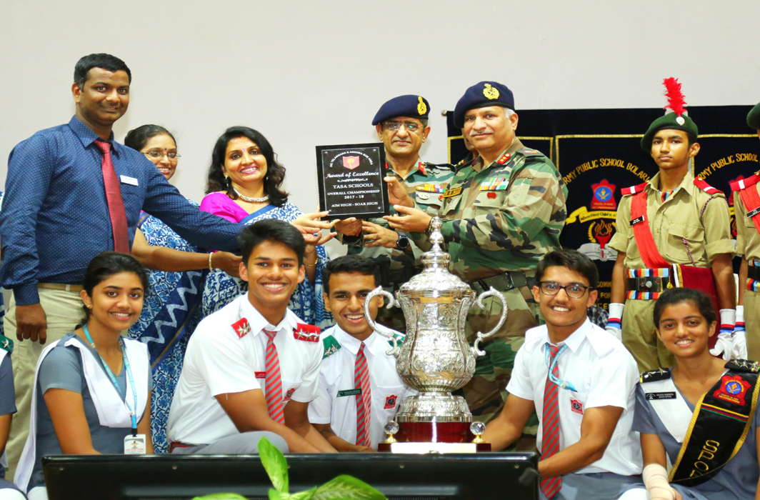 Maj Gen N Srinivas Rao, GOC, Telangana and Andhra Pradesh Sub Area (TASA), presents the TASA School Champions Trophy to the winner Army Public School, Bolarum, at MCEME Auditorium in Secunderabad, UNI