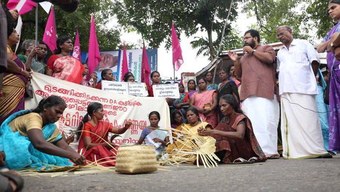 Bamboo workers make products during their protest in front of the Secretariat to press their various demands in Thiruvananthapuram, UNI