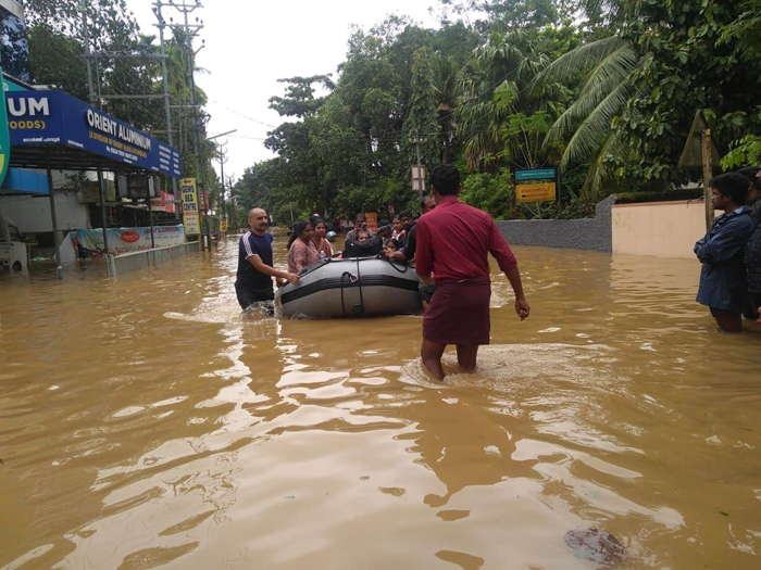 Marooned people being shifted to safer places in Naval boat after flashflood submerged the residential areas in Kochi, UNI