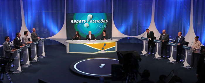 (L-R) Presidential candidates Cabo Daciolo of Patriots, Jair Bolsonaro of the Party for Socialism and Liberation (PSL), Guilherme Boulos of the Socialism and Freedom Party (PSOL), Ciro Gomes of the Democratic Labour Party (PDT), Rede TV journalists Amanda Klein, Boris Casoy, Mariana Godoy, Alvaro Dias of Podemos, Henrique Meirelles of the Brazilian Democratic Movement (MDB), Geraldo Alckmin of Brazilian Social Democratic Party (PSDB) and Marina Silva of the Brazilian Sustainability Network Party (REDE) are seen during a televised debate at the Rede TV studio in Osasco, Brazil, Reuters/UNI