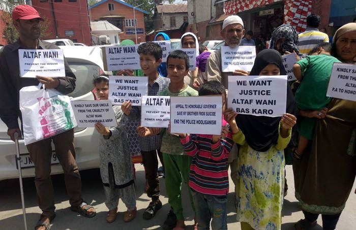 Children hold placards while protesting against one of the officer of Jammu and Kashmir police, at press enclave in Srinagar, UNI